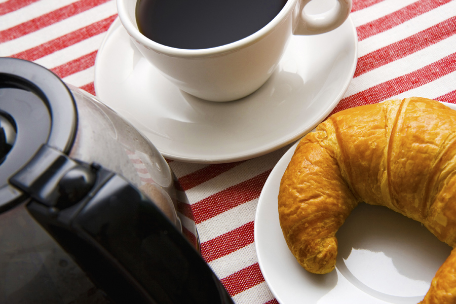 Coffee And Croissant On The Table For Breakfast